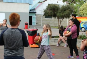 Ray Noble teaching children basketball as part of the active families programme